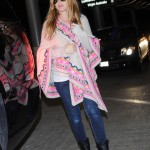 Pregnant Isla Fisher Touches Down at LAX