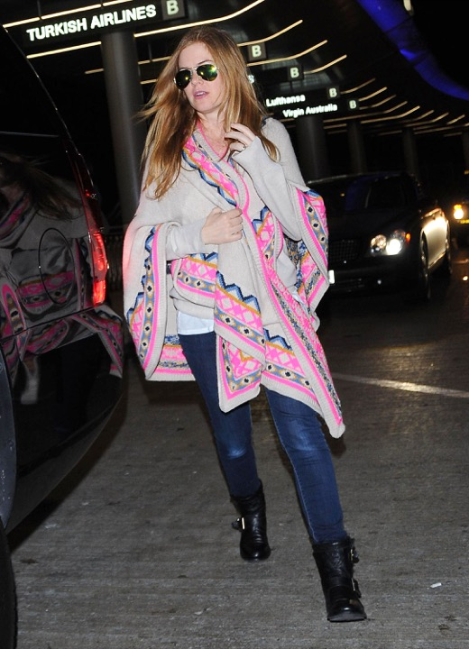 Pregnant Isla Fisher Lands At LAX Airport