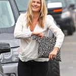 Pregnant Ali Larter Goes Shopping in the Rain