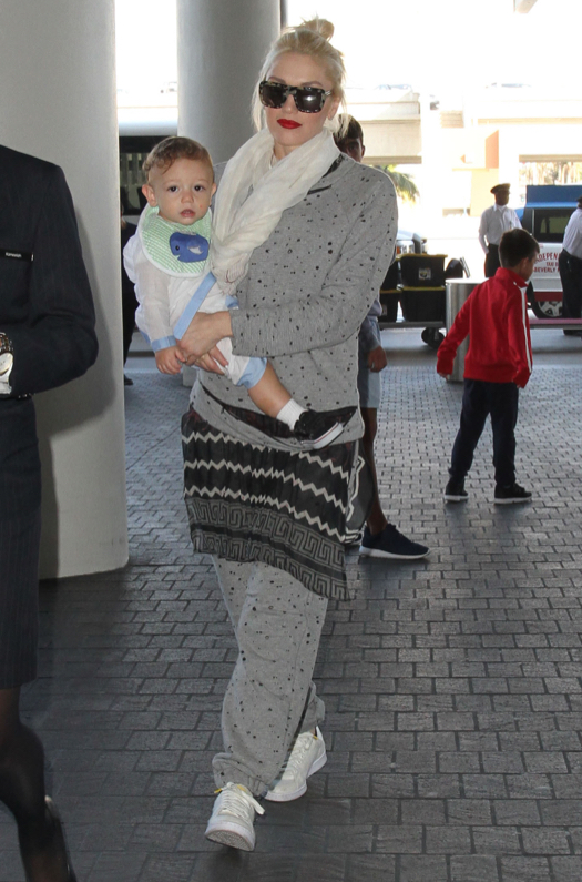 Gwen Stefani & Son Apollo Departing On A Flight At LAX