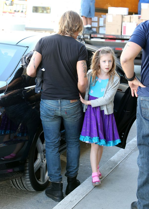 Nicole Kidman and Keith Urban's Daughters Jet Off with Dad in Airport Princess Style
