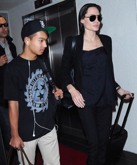 Angelina Jolie Touches Down At LAX With Her Son