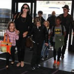 Angelina Jolie & Brad Pitt Catch a Flight With Their Children