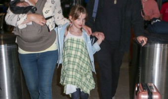 Milla Jovovich & Family Land At LAX Airport