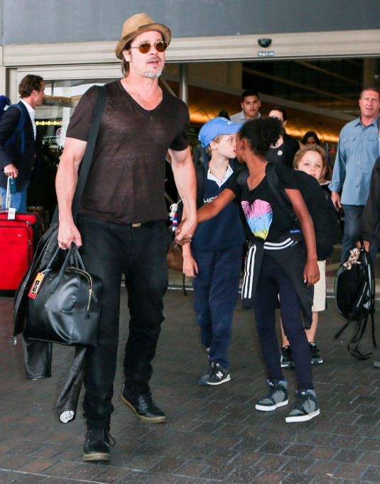 Brad Pitt & Angelina Jolie Arriving On A Flight At LAX With Their Kids