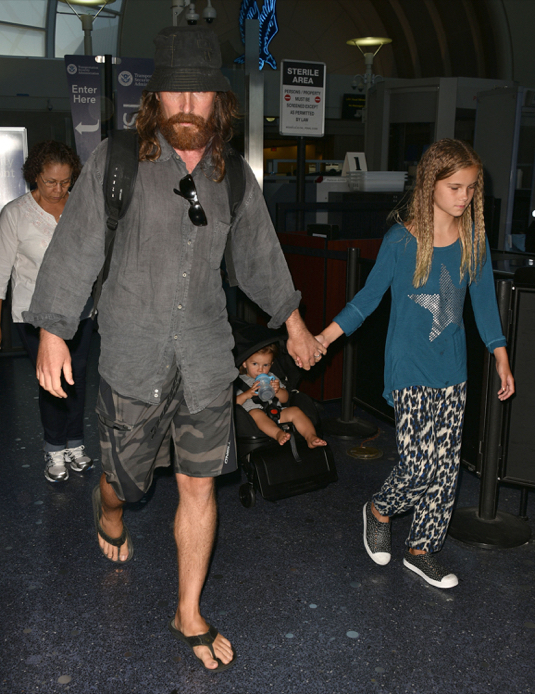 Christian Bale & Family Land At LAX Airport