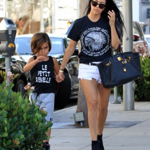 51815457 Reality star Kourtney Kardashian puts her slender legs on display in a pair of very short shorts as she takes her son Mason shopping at Trico Field on August 3, 2015 in  Beverly Hills, California. Kourtney has been showing off her slim figure the last few days, perhaps to show her ex Scott Disick just what he's missing? FameFlynet, Inc - Beverly Hills, CA, USA - +1 (818) 307-4813