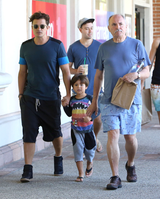 Orlando Bloom Shops At CVS With His Father & Son
