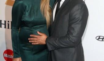 Pregnant Chrissy Teigen Glows in Emerald Gown
