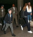 David Beckham & Kids Arriving On A Flight At LAX