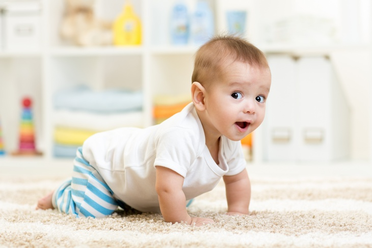 crawling baby boy indoors