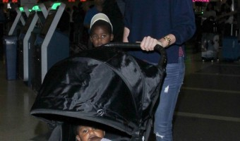 Charlize Theron At LAX With Jackson And August