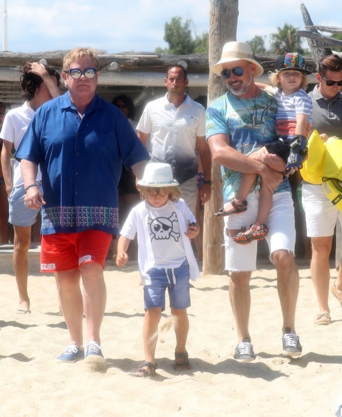 Elton John and husband David Furnish, with sons Elijah and Zachary leaving Club 55 in Saint Tropez, France on August 12, 2016.