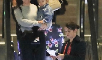 Scarlett Johansson Touches Down With Rose in Paris