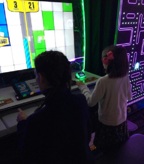 Katie Holmes Takes Suri Cruise To Play Arcade Games