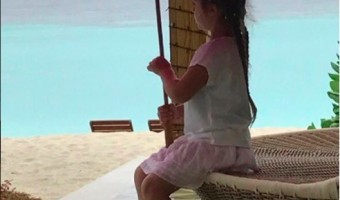 Victoria Beckham's Daughter Sings in the Rain