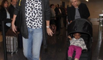 Charlize Theron Jets off With Family