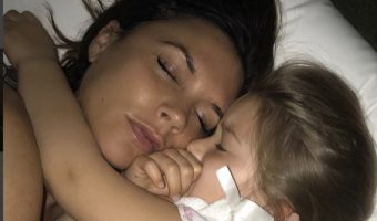 Victoria Beckham Cuddles With Harper
